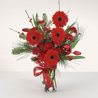 Red Gerbera Daisies Carnations and Tulips w/ Winter Greenery and Holiday Accents in a Glass Urn